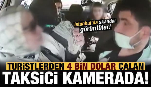 İstanbul'da turistlerden 4 bin dolar çalan taksici kamerada!