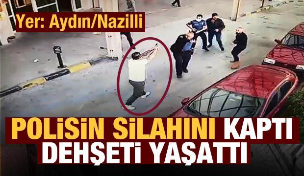 Polisin belindeki silahı alıp rastgele etrafa ateş etti